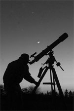 Amatuer Astronomer with Refractor